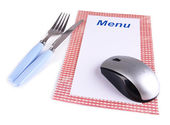 Computer mouse with menu and cutlery isolated on white — Stock Photo
