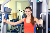 Beautiful woman training with weights in gym  — Stock Photo