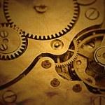 Clockwork details, pinions and wheels closeup — Stock Photo #42325565