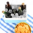 Stock Photo: Ice chest full of drinks in bottles on color napkin, isolated on white