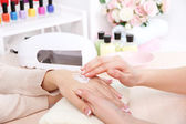 Manicure process in beauty salon close up — 图库照片