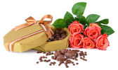 Delicious chocolates in box with flowers isolated on white — Stok fotoğraf