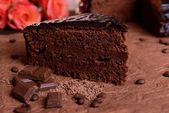 Delicious chocolate cake on table close-up — Stock Photo