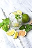 Ingredients for lemonade on wooden table — Stock Photo