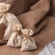 Stock Photo: Jute bags on sackcloth, on wooden background