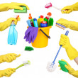 Cleaning items in hands isolated on white — Stock Photo #42473953