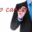 Man writing Stop cancer on transparent board — Stock Photo #42474005