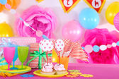 Festive table setting for birthday on celebratory decorations  — Stock Photo