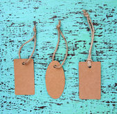 Set of tags on color wooden background — Stock Photo