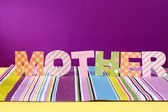 Mother- lettering of handmade paper letters on purple background — Stock Photo