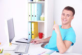 Young creative designer working at office — Stock Photo