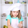 Little girl preparing cookies in kitchen at home — Stock Photo #42598089