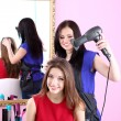Beautiful woman hairdresser do hairstyle girl in beauty salon — Stock Photo #42599525