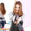 Beautiful girl hairdresser in beauty salon — Stock Photo #42599589