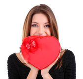 Attractive woman with gift box in form of heart, isolated on white — Stock Photo
