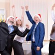Successful young businesspeople at Santa hat at office — Stock Photo #42603241