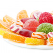 Colorful jelly candies on plate isolated on white — Stock Photo #42604187