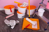 Buckets with paint and ladder on wall background. Conceptual photo of repairing works in  room  — Foto Stock