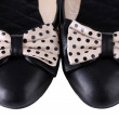 Female flat ballet shoes patterned with black polka dots isolated on white — Stock Photo
