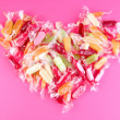 Tasty candies on pink background — Stock Photo