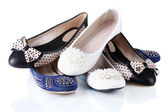 Several pairs of female flat shoes isolated on white — Stock Photo