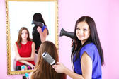 Beautiful woman hairdresser do hairstyle girl in beauty salon — Stock Photo
