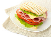 Tasty sandwich with ham, isolated on white — Stock Photo