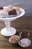 Set of chocolate candies on table on grey background — ストック写真