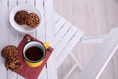 Composition with cup of hot drink and cookies on wooden table background — Stock Photo