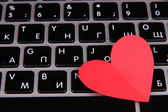 Red heart on computer keyboard close up — Stock Photo