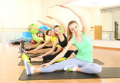 Group of young people engaged in the gym — Stock Photo