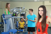 Young beautiful girls in gym — Stock Photo