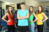 Young beautiful peoples in gym — Stock Photo