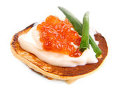 Pancake with red caviar isolated on white — Stock Photo