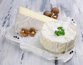 Tasty Italian cheese on wooden table — Stock Photo