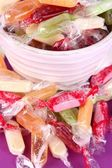 Tasty candies in mug on table close up — Stock Photo