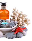 Composition with spa stones, candle, coral and star fish, isolated on white — Stock Photo
