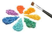 Rainbow crushed eyeshadow in shape of flower isolated on white — Stock Photo