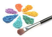 Rainbow crushed eyeshadow in shape of flower isolated on white — Stock Photo