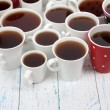 Many cups of tea on table close-up — Stock Photo #42761423