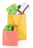 Presents in paper bags isolated on white — ストック写真