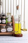 Historic old pharmacy bottles with label and weight scales on color wooden background — Stock Photo
