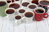 Many cups of tea on table close-up — Stock Photo