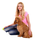Beautiful young woman with cocker spaniel isolated on white — Stock Photo