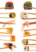 Collage of chopsticks with different food isolated on white — Stock Photo