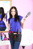 Beautiful girl hairdresser in beauty salon — Stock Photo