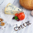 Tasty blue cheese and bread on old wooden table — Stock Photo