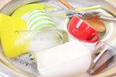 Utensils soaking in kitchen sink — Stock Photo