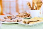 Variety of bread sticks on table, on bright background — Stock Photo