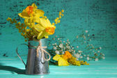Beautiful spring flowers in vase on wooden table — Stock Photo